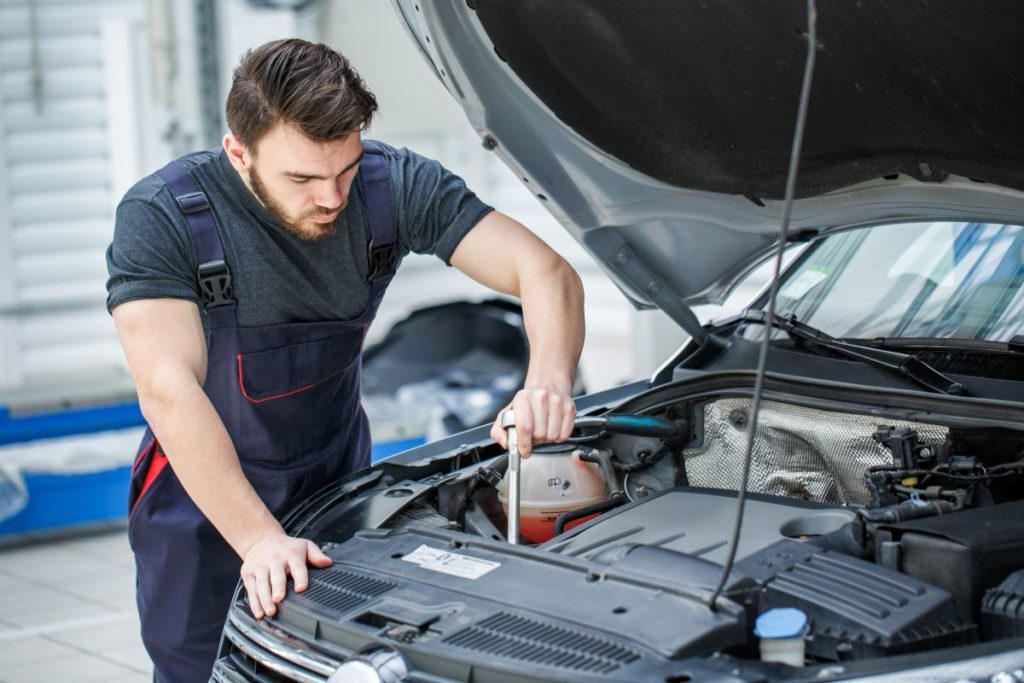 mechanic working on car