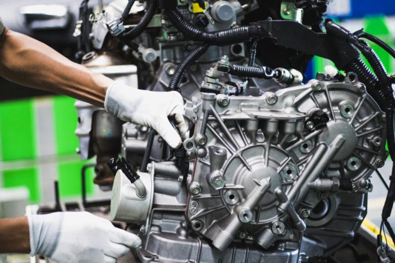mechanic fixing engine